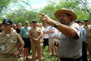 Pearl Harbor (March 16, 2006) - National Park Service Ranger Daniel Martinez addresses a group of Sailors from the Pearl Harbor Surface Navy Association (SNA) at the site of the USS Arizona relics. The Arizona relics are parts of USS Arizona that were removed from the water and placed on shore near Pearl Harbor's West Loch. U.S. Navy photo by Chief Journalist Joe Kane (RELEASED)