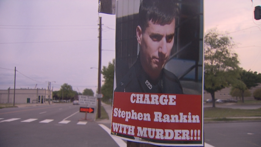 "Poster of Stephen Rankin with the the words ""Charge Stephen Rankin with murder"""