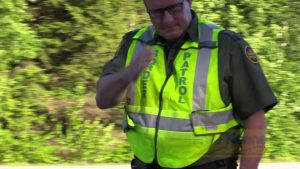 Border Patrol Checkpoint Agent Salutes Camera